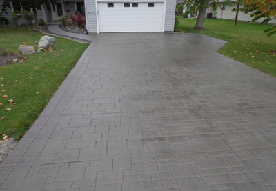 Dark brown paver style stamped concrete.