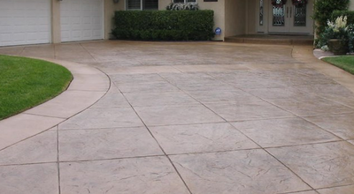 Tile style stamped and stained concrete driveway
