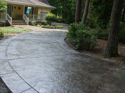 Long dark stained and textured driveway in Milford.