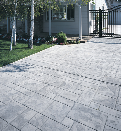 Textured and stamped gray concrete patio.