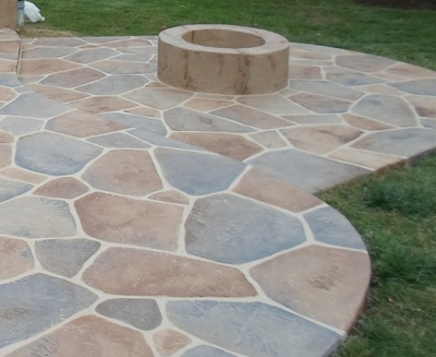 Multi-colored sandstoned backyard patio, with a built in fire pit in Connecticut.