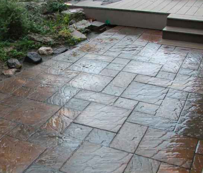 Stone paver style stamped concrete patio in Milford.