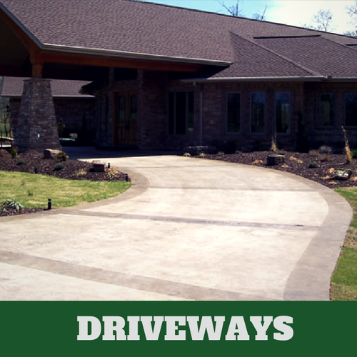 Two toned colored concrete driveway in Milford, CT with brick home.