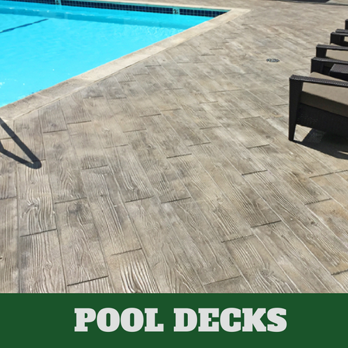 Lansing stamped concrete pool surround with a wood grain finish.