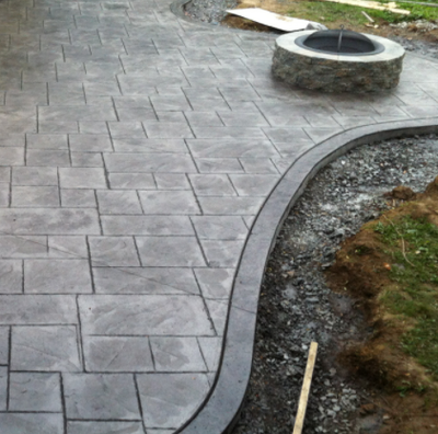 Gray stained and stamped concrete walkway.