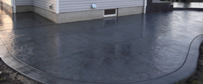Gray stained and polished stamped concrete in CT.