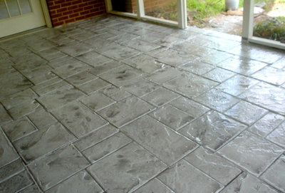 Gray stamped concrete with stone paver style.
