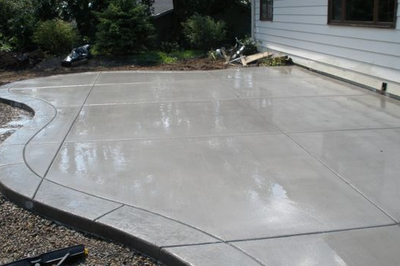 Polished concrete patio with stamped concrete edging.