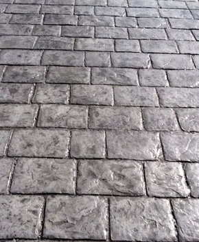 Worn our cobblestone style stamped concrete.